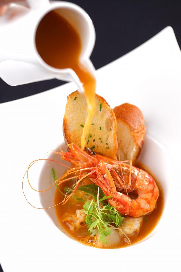 Seafood soup with garlic bruschetta