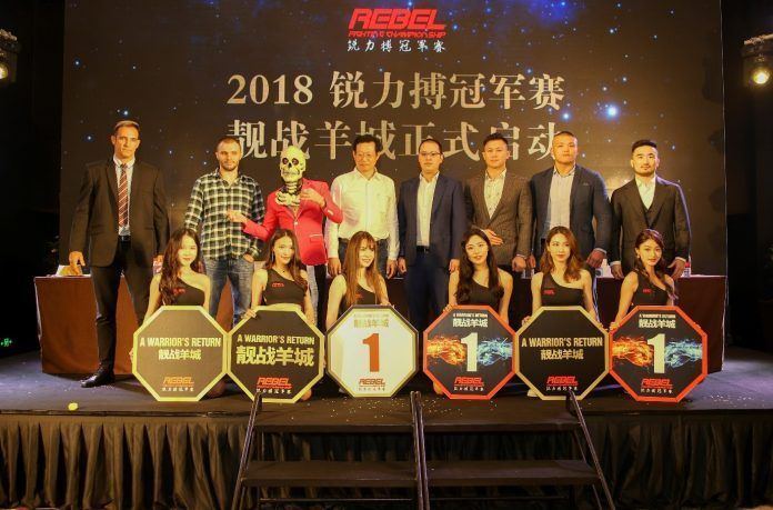 Zhou Chun, director of Guangdong Sports Channel (fourth from left) and REBEL FC CEO Justin Leong (fifth from left) together with the main MMA stars and ring girls of REBEL FC 8 – A Warrior's Return.