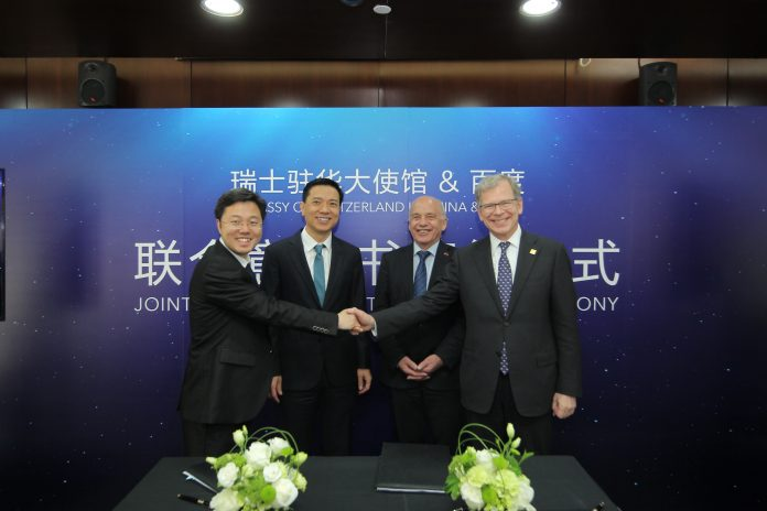 "Robin Li, Chairman and CEO of Baidu (second from left), and Ueli Maurer, President of the Swiss Confederation (second from right), attended the Joint Letter of Intent signing ceremony and launched the ""Switzerland"" Mini Program on Baidu App at Baidu headquarters in Beijing on 25th April, 2019."